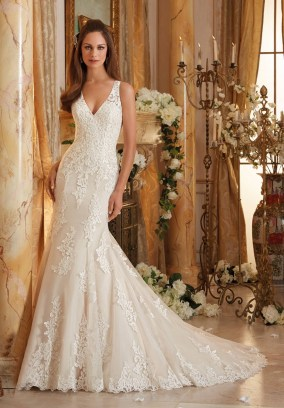 Style 5469 - Frosted Beading on Embroidered Appliques and Wide Hemline onto Soft Net Wedding Dress