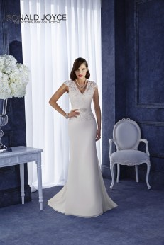 Ombrietta - A CAPPED SLEEVE LACE BODICE WITH OPEN BACK ON A SLIM FIT SKIRT WITH SATIN BEADED WAISTBAND