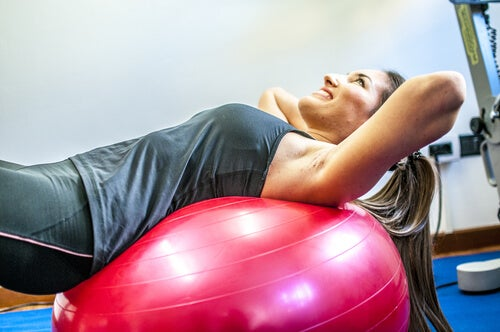Woman exercising with a balloon