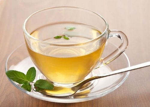 """infusion of tea, ginger and lemon to lose weight """"width ="""" 500 """"height ="""" 357 """" data-recalc-dims="""
