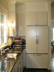 Panels on the refrigerator streamline the cabinetry.