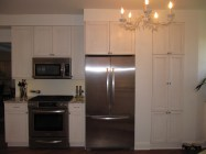 A hollow plumbing wall yielded additional cabinet storage space to the right of the refrigerator.