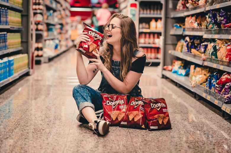 woman holding bag of chips