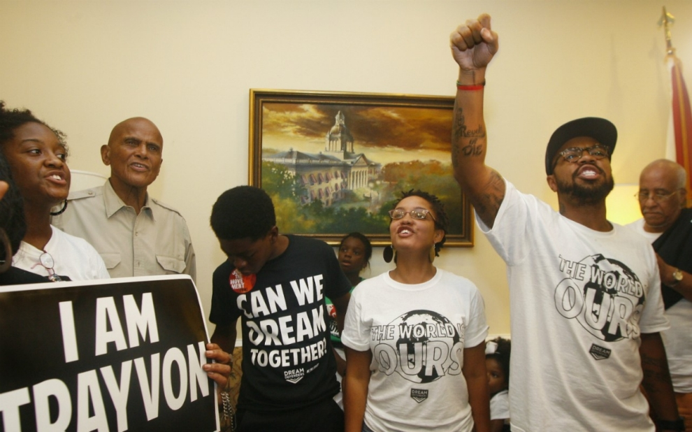 Agnew, right, and the Dream Defenders were joined by Belafonte, second from the right, as they went into their 11th day of a sit-in of Florida Gov. Rick Scott's office in July 2013. The sit-in was their response to the 'not guilty' verdict in the trial of George Zimmerman, the Florida neighborhood watch volunteer who fatally shot Trayvon Martin.