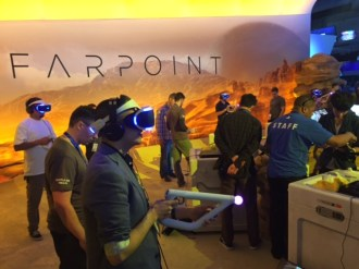 Visitors to E3 Gaming Expo check out the game Farpoint.
