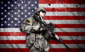 soldier holding rifle on a american flag background