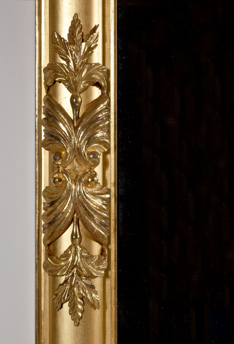 Classical Carved Gilt-wood Pier/ Over-mantle Mirror: Detail of foliate carving at mid-column.