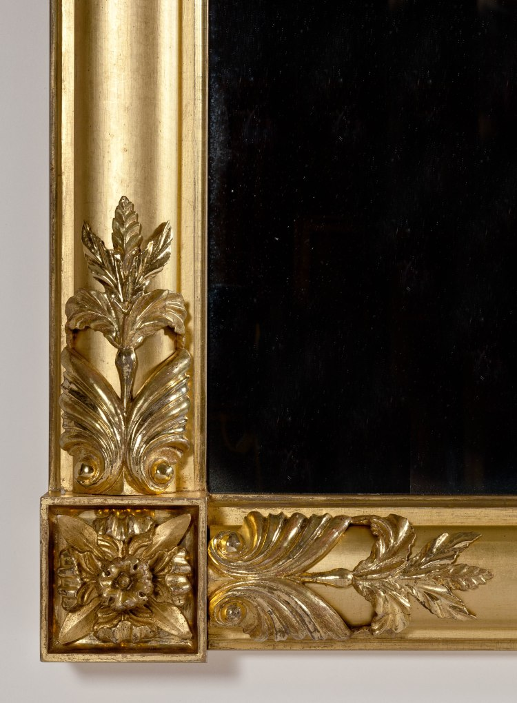 Classical Carved Gilt-wood Pier Mirror: Detail of foliate carving and corner rosettes.