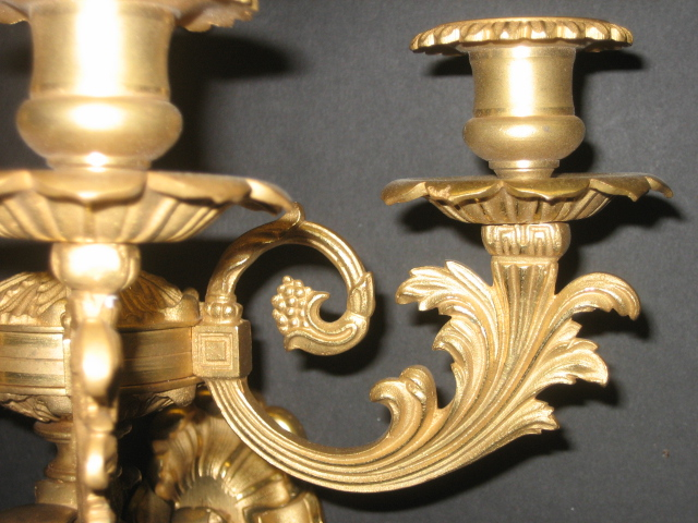 Pair of Gilt-Bronze 5-Light Sconces: Detail of one foliate candle arm and candle cup.