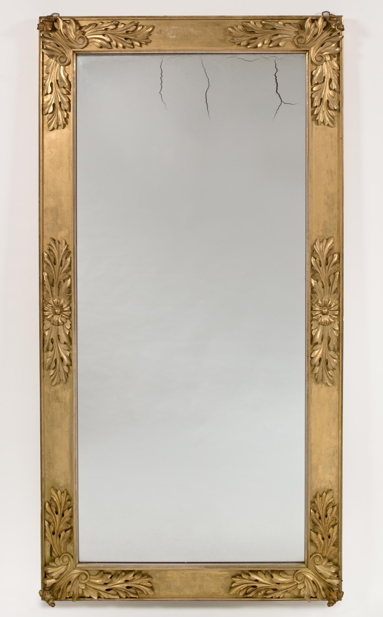 Carved Gilt-wood Pier Mirror by Charles Robinson: The paneled and gilded rectangular frame with bold acanthus leaf carving at the corners and mid-span between the corners, holding the original single heavy plate glass.  36½ inches x 70¾ inches