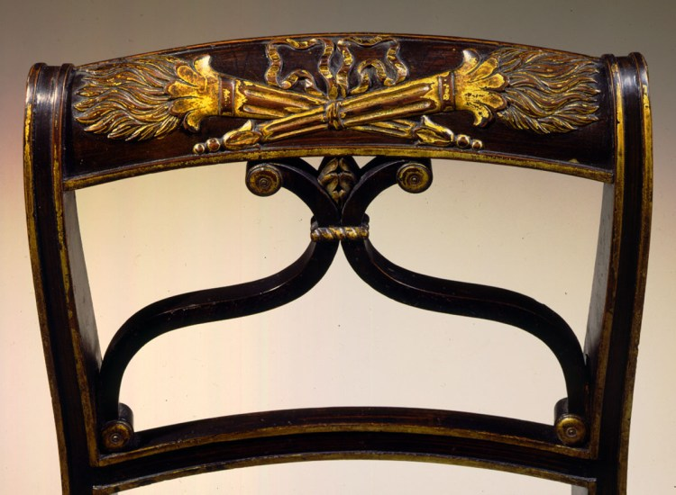 Carved, parcel-gilt and faux-grain painted Federal Chairs: Detail of scrolled back with crest-rail bas-relief-carved and gilded crossed, flaming torches, above a double cyma-shaped splat.