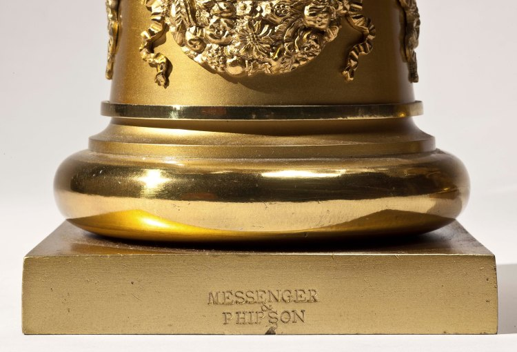 Pair of Brass Candelabra by Messenger & Phipson: Detail of base showing impressed mark of Messenger & Phipson.