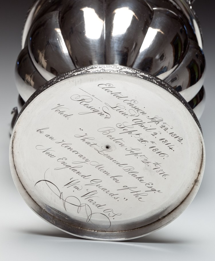 """Coin Silver Presentation Pitcher by Farnum & Ward, Detail of base with engraved inscription: Elected Ensign Sep. 22, 1812./ Lieu. April 2, 1814/ Resign'd Sep. 26th 1816./ Boston Sep. 26th 1816/ Voted. """"That Lemuel Blake Esq./ be an Honorary Member of the/ New England Guards.""""/Wm. Ward OS."""