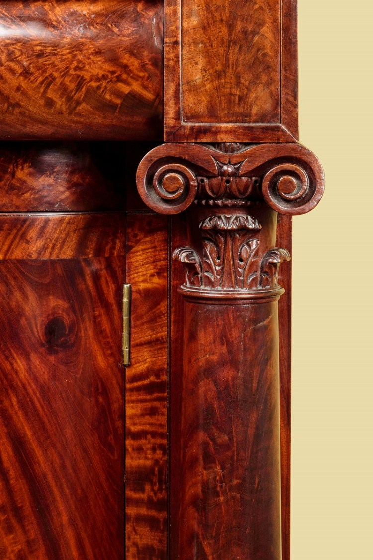 PEDESTAL-END FRENCH SIDEBOARD by John Needles: detail of carved mahogany Ionic column capital.