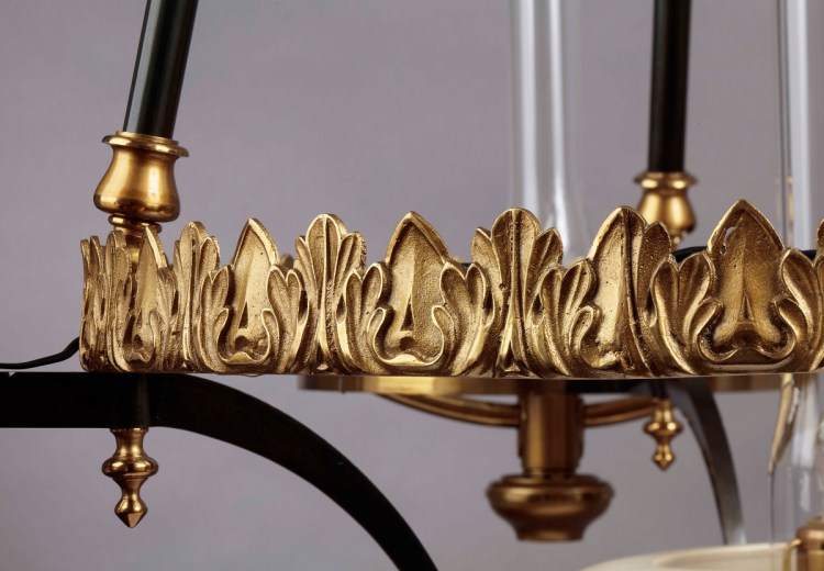 Sinumbra Chandelier detail of main cast brass foliate ring.