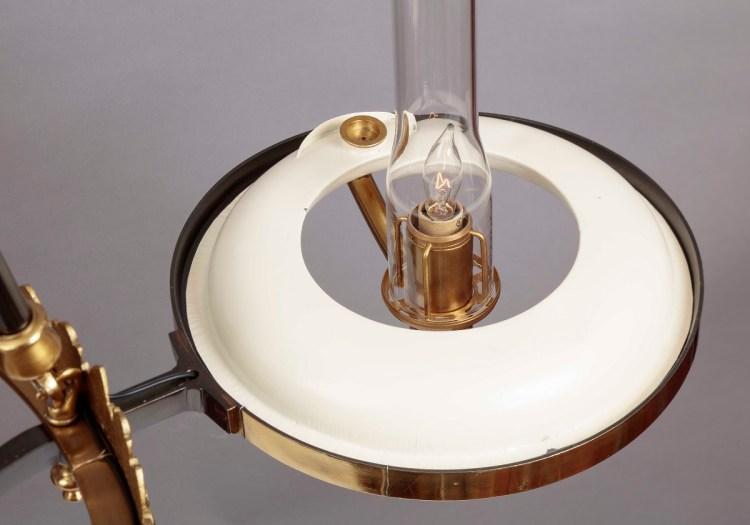 Sinumbra Chandelier detail of sinumbra oil font, electrified burner tube, chimney holder and glass chimney.