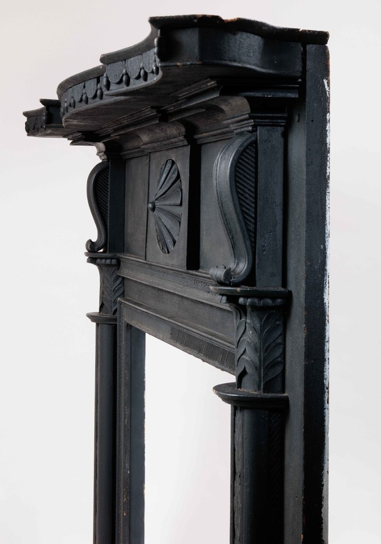 Side view showing tambour shelf decoration and depth of corbels and columns