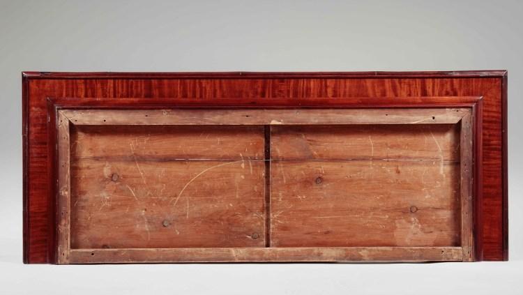 NY Armoire cornice underside showing knife edge molding and cross banded veneer.