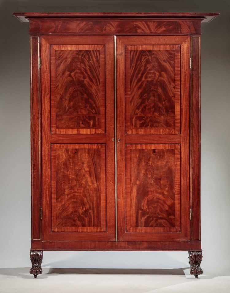 Classical Armoire or Wardrobe front showing the pilasters outlined with brass string inlay flanking the cabinet doors