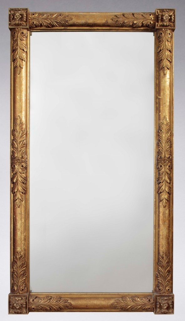 Foliate-carved gilded pier mirror with untouched original surface. The single mirror plate framed by engaged columns  overlaid with foliate carving , terminating in each corner with large square rosettes.