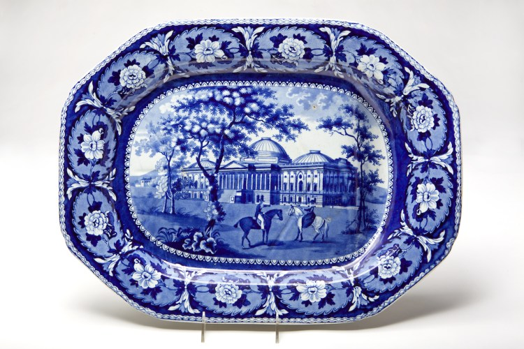 """Blue and White Transfer-Pattern Octagonal Meat Platter with an image of the US Capitol, marked """"Beauties of America/ Capitol/ Washington/ J. & W. Ridgway, The octagonal earthenware platter with a repeating rose border with an image of the US Capitol building and two equestrians in the foreground."""