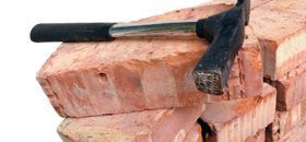 hammer on masonry bricks