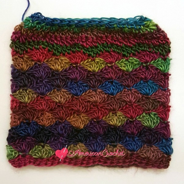 Carousel Dream Messy Bun Hat | Free Crochet Pattern | American Crochet @americancrochet.com #freecrochetpattern