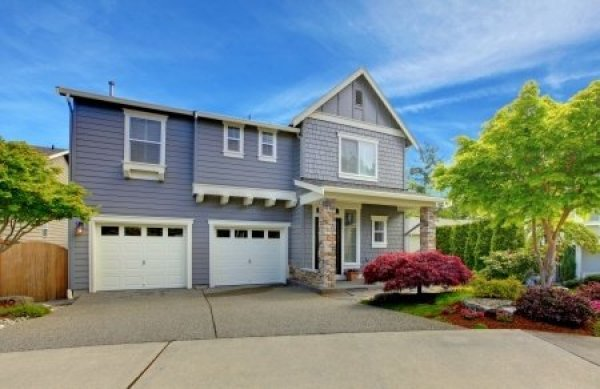 suburban two story home with two garage doors