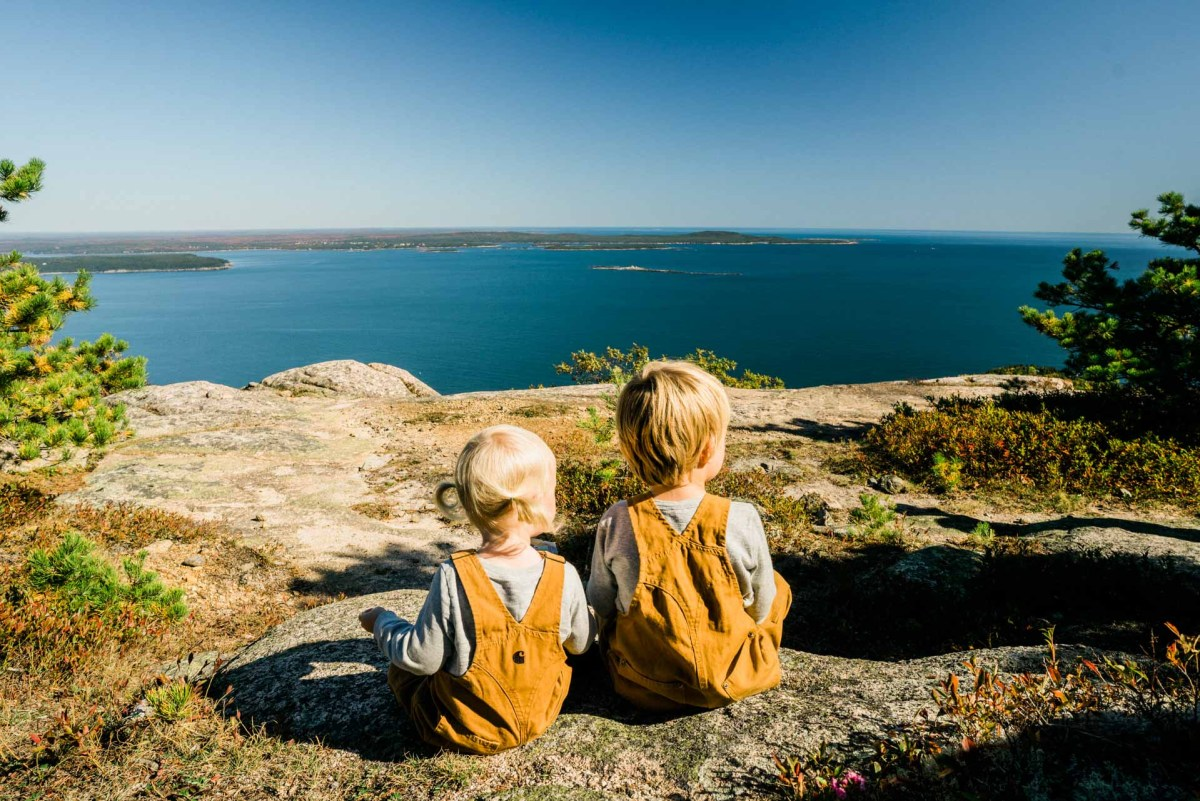 two kids hiking in acadia national park