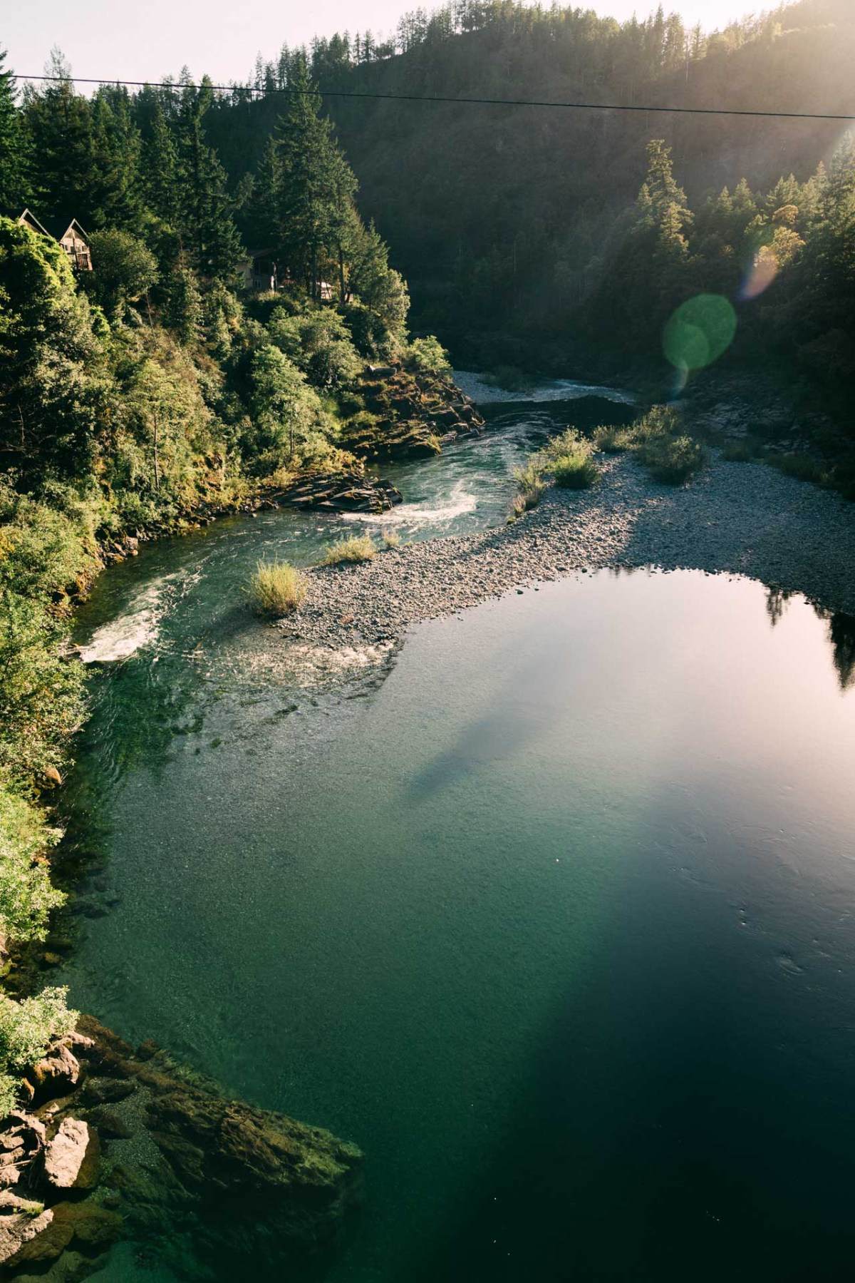 sunset over the blue water of the smith river outside redwood national park
