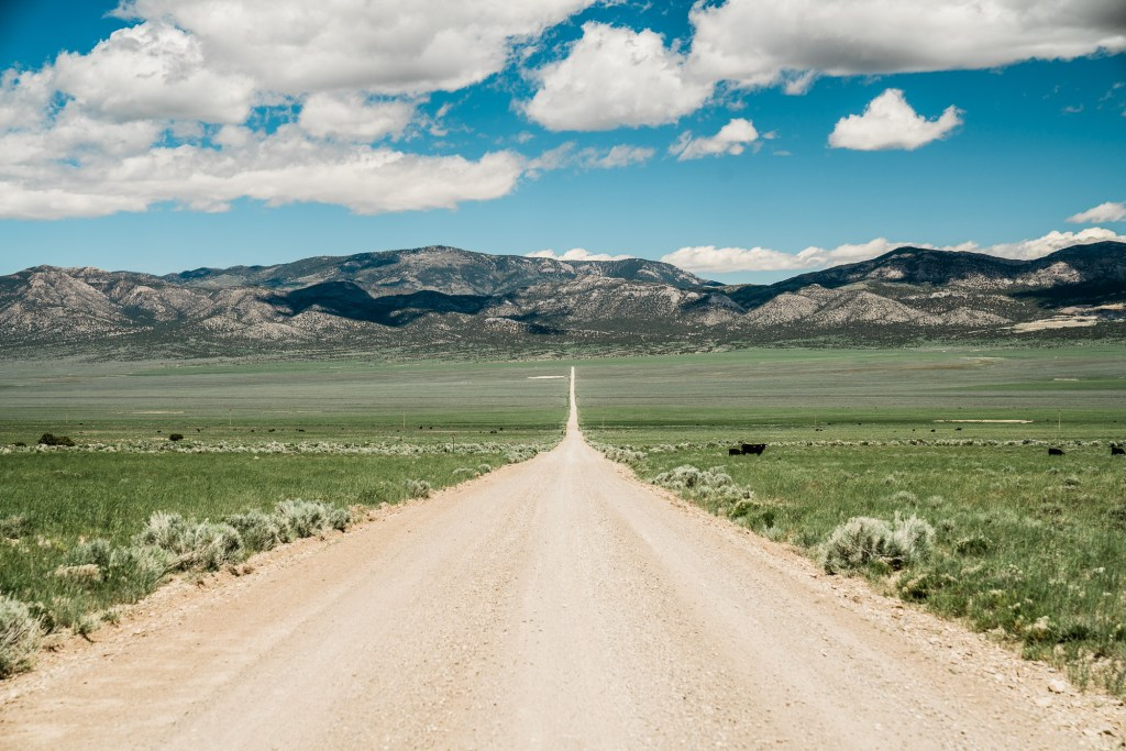 empty road through nevada's great basin