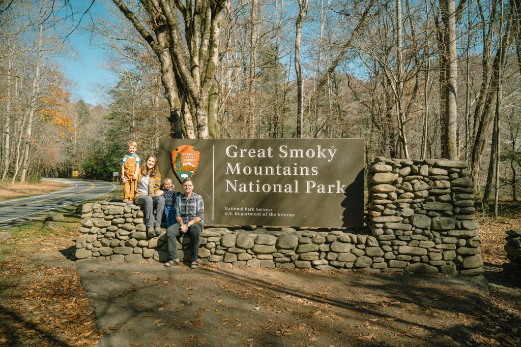 family with sign at great smoky mountains national park