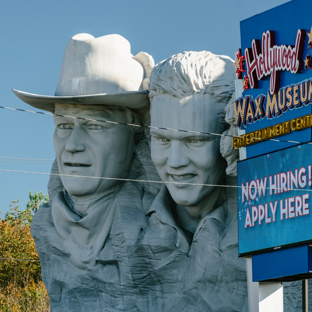 elvis and john wayne sculptures in pigeon forge
