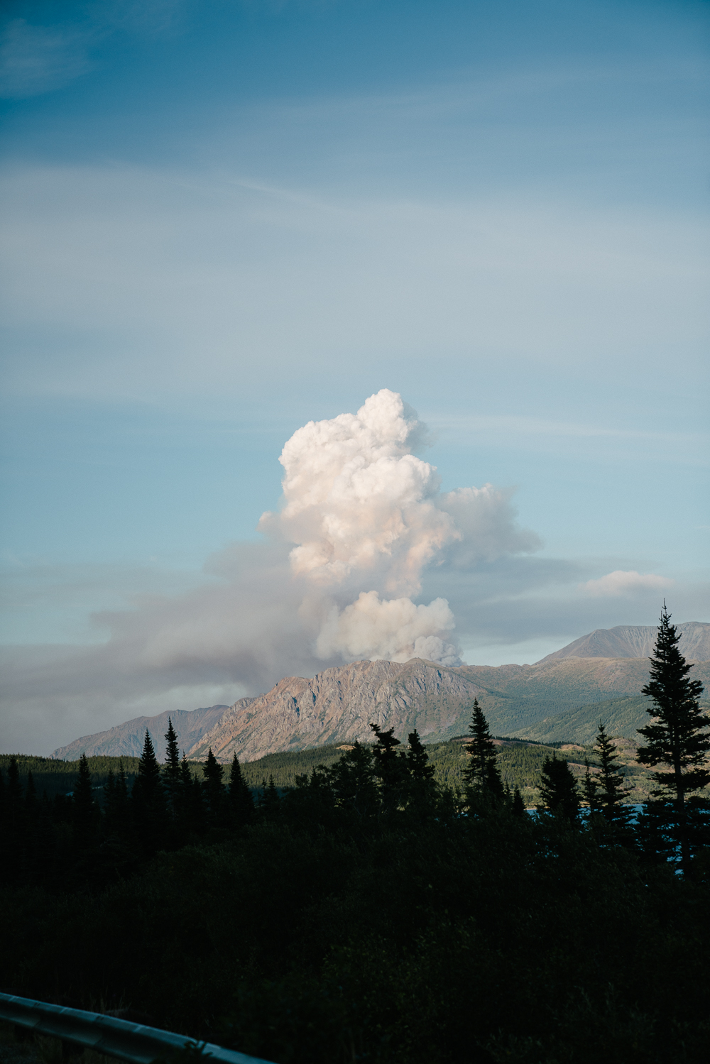 Coming over the White Pass, we caught a forest fire just beginning—it looked like a volcano had erupted!