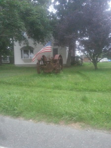 American Flag on an antique Tractor