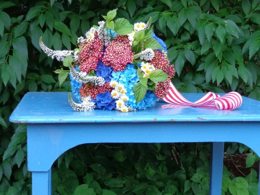 A child's table, painted delphinium blue by a vintage dealer, is my perfect podium for this bouquet.