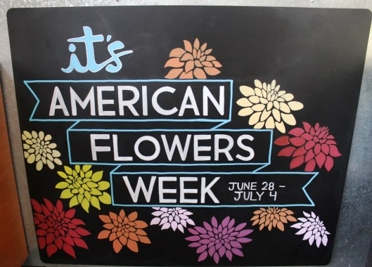 Hand-lettered chalk signs announce American Flowers Week at New Seasons Market in Portland