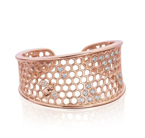 This rose gold bracelet features a small diamond encrusted honeybee.
