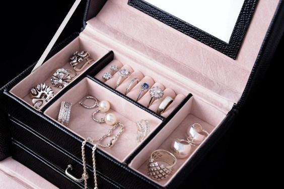 Jewelry box with white gold and silver rings, earrings and penda