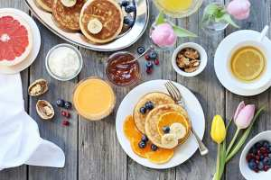 A layout of breakfast foods on a wooden table