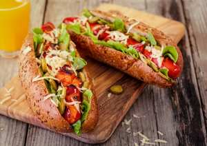 Barbecue Grilled Hot Dog With Cucumber, Cheese And Salad