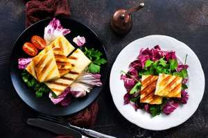 Salad with halloumi cheese aand various vegetables on a table