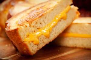 Grilled cheese sandwich with melted cheese made on an American Griddle