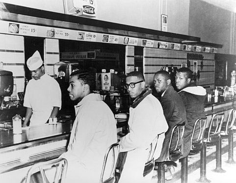 On the second day of the Greensboro sit-in, Joseph A. McNeil and Franklin E. McCain are joined by William Smith and Clarence Henderson at the Woolworth lunch counter in Greensboro, North Carolina. (Courtesy of Greensboro News and Record)