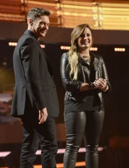 Demi Lovato with Ryan Seacrest on American Idol