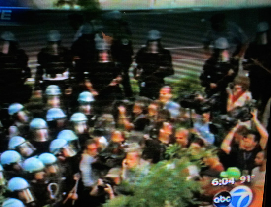 Channel 7 coverage of a NATO protest, May 20th, with cameramen in the midst of the crowd (author photo)