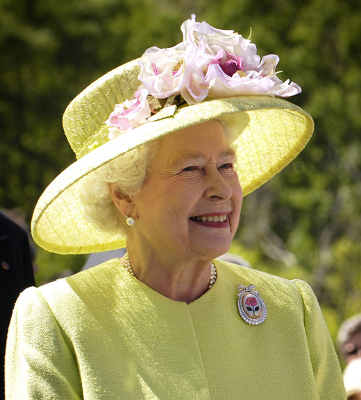 Photograph of Queen Elizabeth II wearing a hat adorned with flowers