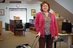In her position as tribal aide to elders, Judi Bridge helps the senior citizens of Winnebago, Nebraska, make the most of the library.