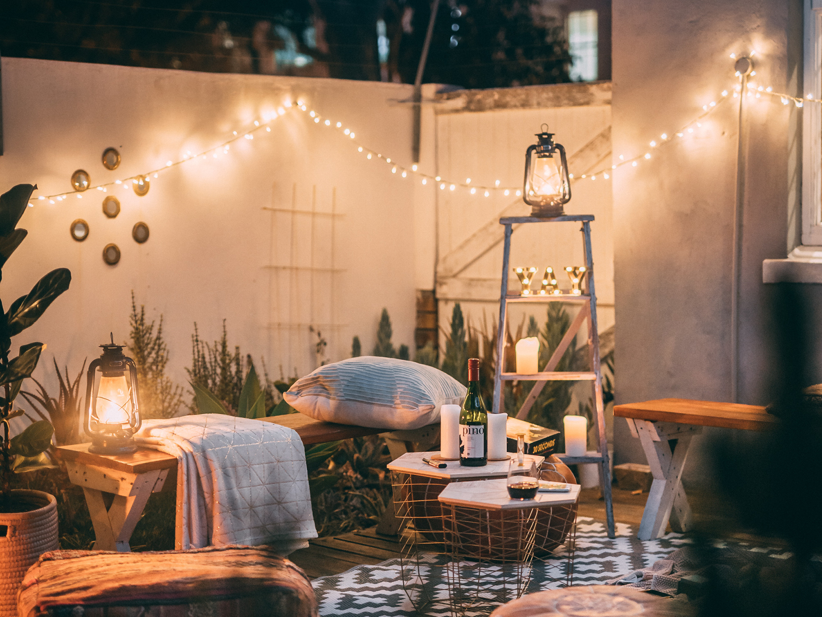 backyard space with lights and fence