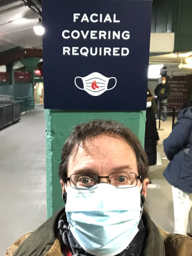 Author in a mask at a vaccine location in MA, USA.